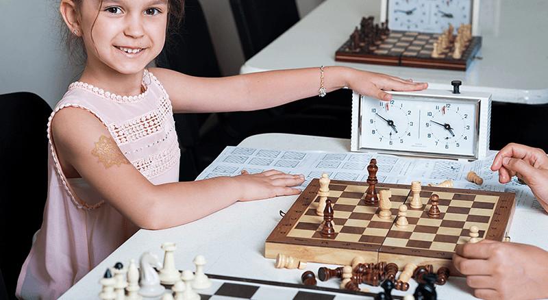 girl in chess school program