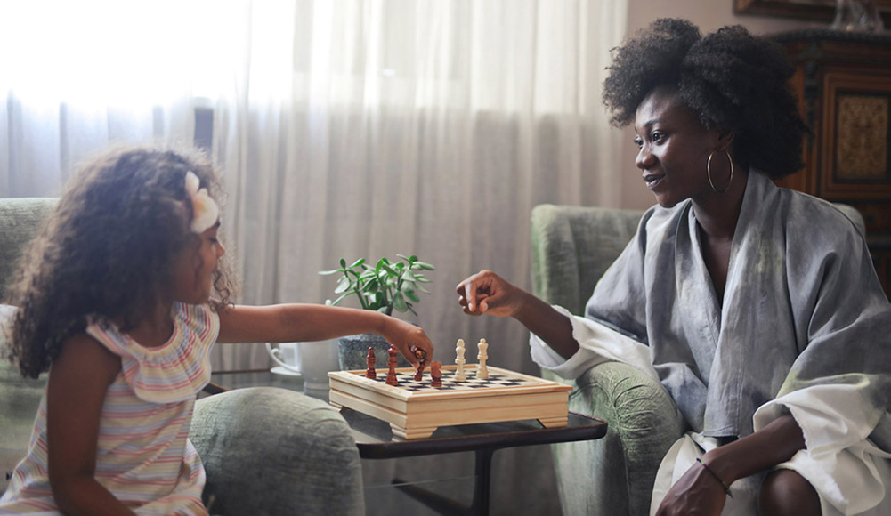 Mother And Daughter Play Chess