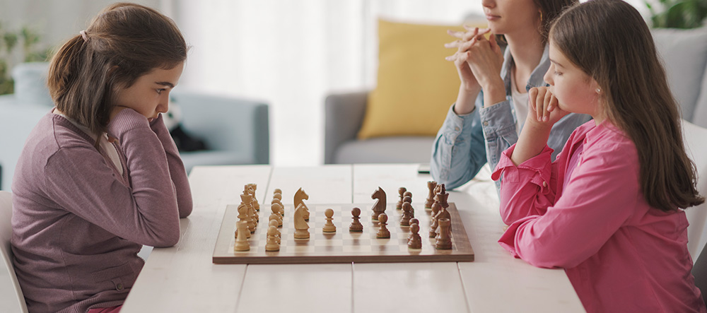 Girls Learning How To Play Chess