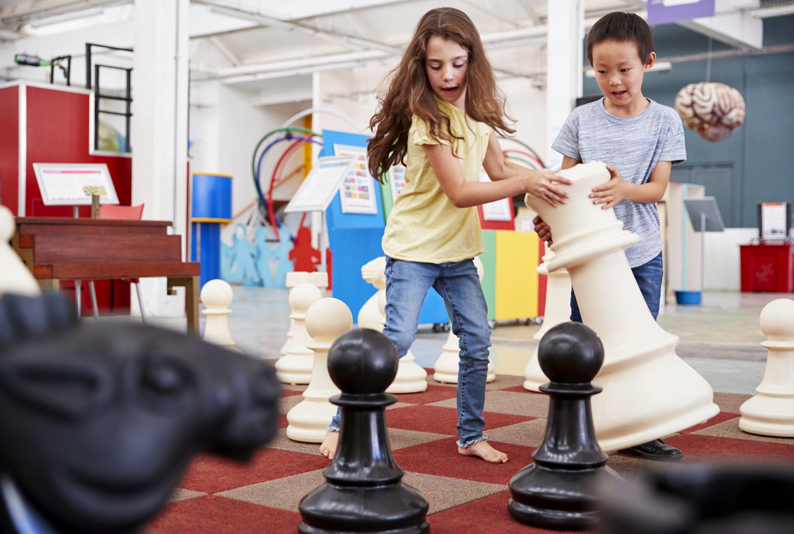 2 Children Playing Chess